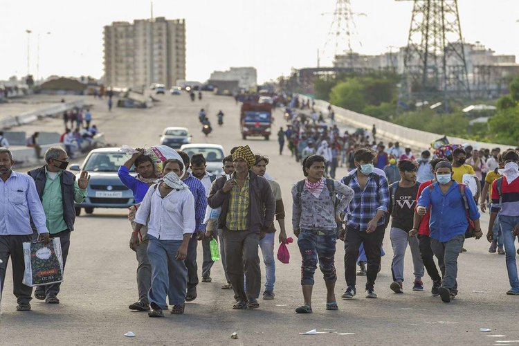 As India enters lockdown 4, Migrants seen at Delhi-UP border waiting to reach home